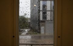 Rain is seen through a window on Monday, Aug. 10, 2020. With wind gusts around 80 mph, the derecho ­--a widespread wind damage event produced by severe thunderstorms-- hit Iowa City in the afternoon causing tree damage and power outages.