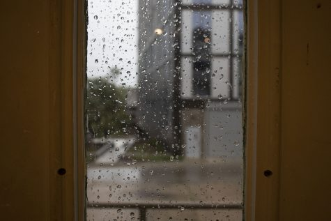Rain is seen through a window on Monday, Aug. 10, 2020. With wind gusts around 80 mph, the derecho --a widespread wind damage event produced by severe thunderstorms-- hit Iowa City in the afternoon causing tree damage and power outages.