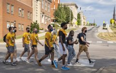 OnIowa members lead a tour of campus for first-year students on Aug. 22, 2020.