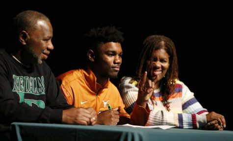 Kobe Boyce of Lake Dallas High School poses for photos with his parents David Boyce and Mary Flowers Boyce after signing his letter of intent to play football at the University of Texas during signing day at Lake Dallas High School on Wednesday, February 1, 2017. (Vernon Bryant/Dallas Morning News)