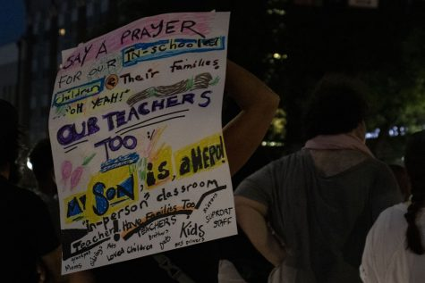 A protest sign directed at in-person classes during a pandemic is seen on Friday, Aug. 28, 2020 during a protest supporting Black Lives Matter.