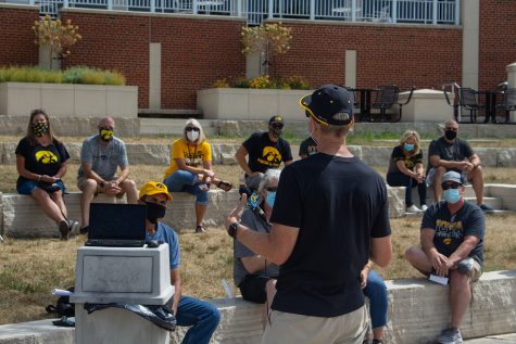 Head Coach Marc Long addresses the audience at the save swim meeting outside the IMU on Aug. 29, 2020.