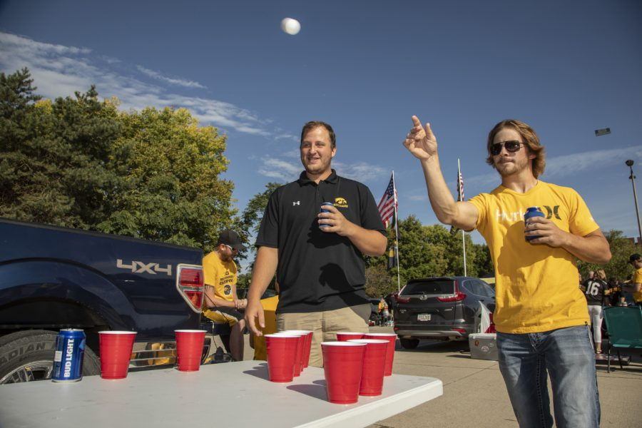Blake Ossian of Washington, Iowa throws a ping pong in a game of beer pong during the tailgate before the Iowa vs. Rutgers game on September 7, 2019.