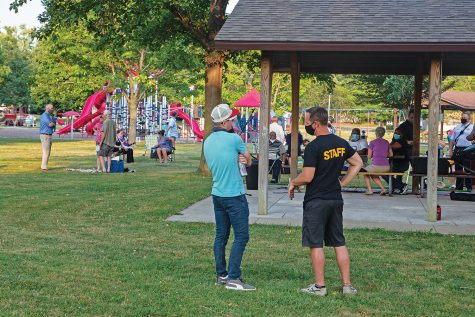 Candidates for Iowa City's next Police Chief had the opportunity to speak to community members during a public forum at Mercer Park on Monday, August 24 in Iowa City. Each candidate had 5-10 minutes to address the crowd and then had the opportunity to go around and speak with community members directly. As the forum neared its end, community members continued to socialize and discuss the events of the forum.