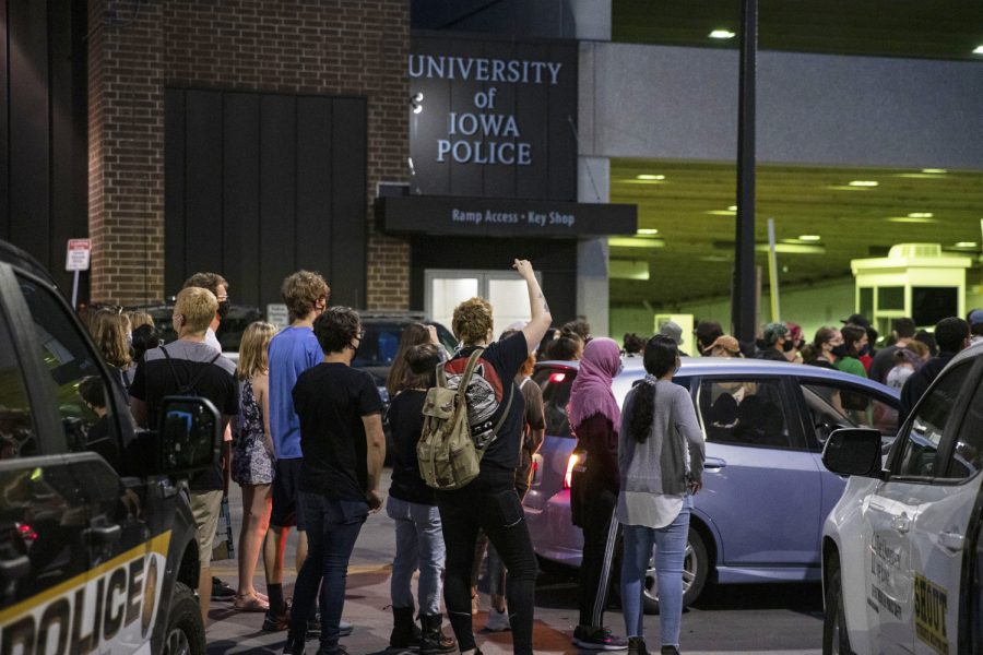 Protesters stop outside of the University of Iowa Police Department during a Black Lives Matter protest organized by the Iowa Freedom Riders on Sunday, Aug. 30, 2020. This was the third protest of a four-day protest streak in which protesters took to the street to put pressure on the Iowa City City Council. These protests lead up to a Tuesday meeting during which three of their demands will be discussed.