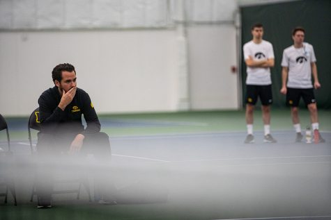Iowa head coach Ross Wilson watches his team play during a men