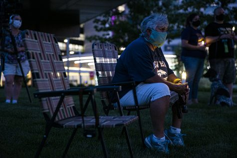 TIffin resident, Karen Kieth-Zamora sit in silence during a candlelight vigil at University of Iowa Hospitals and Clinics on Monday, August 26th, 2020. SEIU, along with several nurses and community members held a candlelight vigil to honor the nurses who passed away from COVID-19.