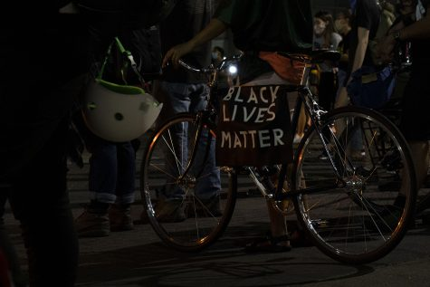 A BLM sign is seen on a bike on Friday, Aug. 28, 2020. Protesters marched to the Johnson County Sheriff's Office and throughout downtown Iowa City demanding justice for the shooting of Jacob Blake that happened on Sunday in Kenosha, Wis. and against the recent decision by Iowa City City Council to give the ICPD $230,000 over five years. (Hannah Kinson/The Daily Iowan)