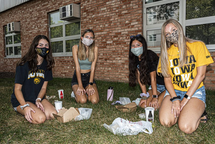 University of Iowa freshmen Calista Smith, Natalie Duran, Annika Thoa, and Claire Enyart pose for a portrait in front of Burge Residence Hall on Monday, August 17th, 2020. The university is currently attempting to adjust their housing and orientation plans around the Coronavirus pandemic to maintain health and safety. (Tate Hildyard/ The Daily Iowan)