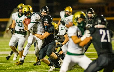 West quarterback Marcus Morgan carries the ball during a football game between Iowa City West and Liberty High School in North Liberty on Friday, Aug. 28, 2020. The Trojans defeated the Lightning, 27-0.
