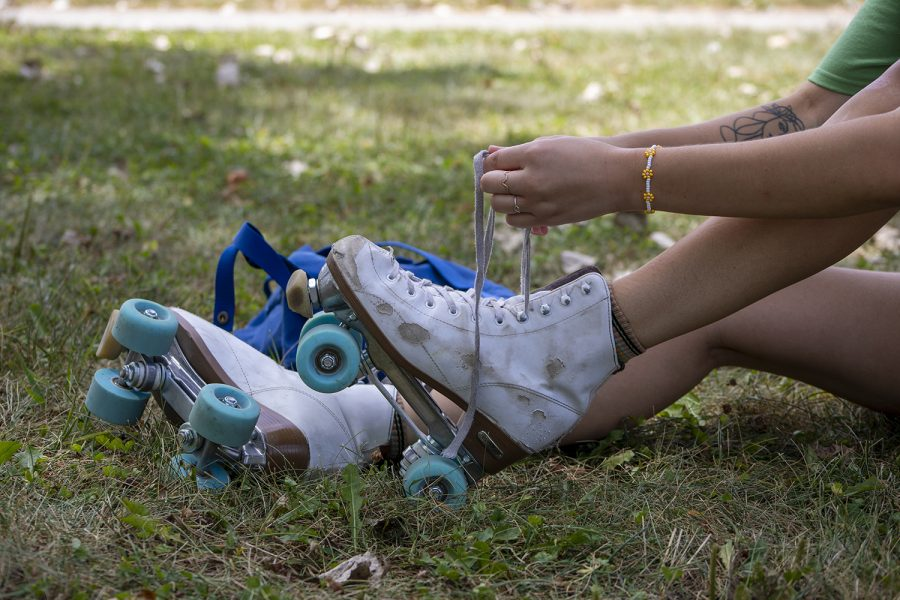 Ellie Zupancic ties her skates before she goes into the skate park on August 29, 2020.