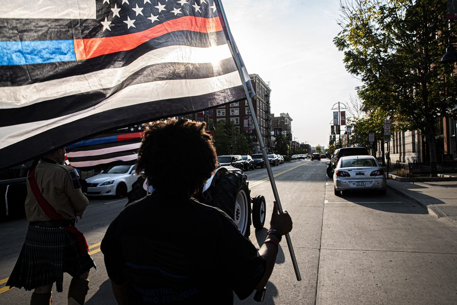 A woman of color marches through downtown Iowa City as part of the the Back the Blue protest on Friday, September 25th, 2020. Citizens marched through downtown Iowa City to show solidarity with the local police force and as a counter protest the Black Lives Matter activity that took place over the past few months.