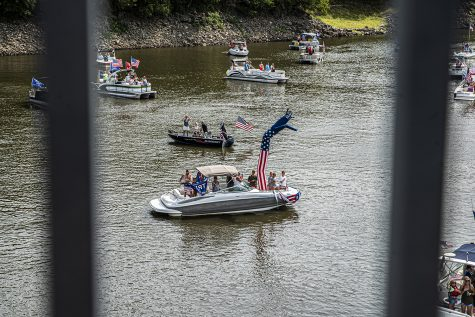 A group of boats decorated in Donald Trump paraphernalia pass under a bridge on Monday, Sept. 7, 2020. For Labor day, a group of local Trump supporters decided to drive their boats around Coralville Lake to celebrate and to show support for President Trump.