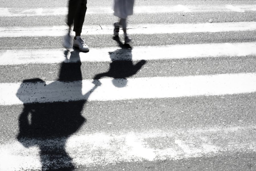 Blurry+shadow+and+silhouette+of+mother+and+child+at+zebra+crossing.
