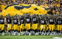 Iowa players walk onto the field for the first game of their season  against Miami (Ohio) at Kinnick Stadium on Saturday, August 31, 2019. The Hawkeyes defeated the Redhawks 38-14.