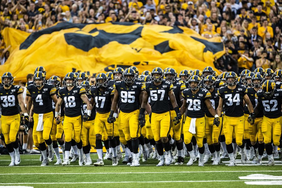 Iowa+players+walk+onto+the+field+for+the+first+game+of+their+season++against+Miami+%28Ohio%29+at+Kinnick+Stadium+on+Saturday%2C+August+31%2C+2019.+The+Hawkeyes+defeated+the+Redhawks+38-14.+