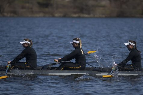 Iowas second varsity crew rows back after losing to Wisconsin by 6.07 seconds in the first session of a womens rowing meet on Lake MacBride on Saturday April 13, 2019. Iowa won 3 out of 12 races with the varsity 8 crew winning both races for the day.