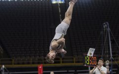 Iowa's Stewart Brown performs his floor routine during a Men's gymnastics meet against The University of Minnesota and the University of Illinois at Chicago. The Hawkeyes won with a final team score of 400.00.