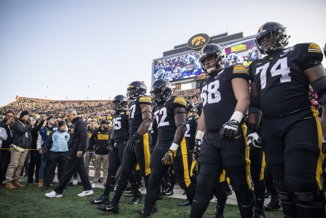 Iowa head coach Kirk Ferenzt and members of the Iowa football team walk onto the field before a football game between Iowa and Minnesota at Kinnick Stadium on Saturday, November 16, 2019. The Hawkeyes defeated the Gophers, 23-19.