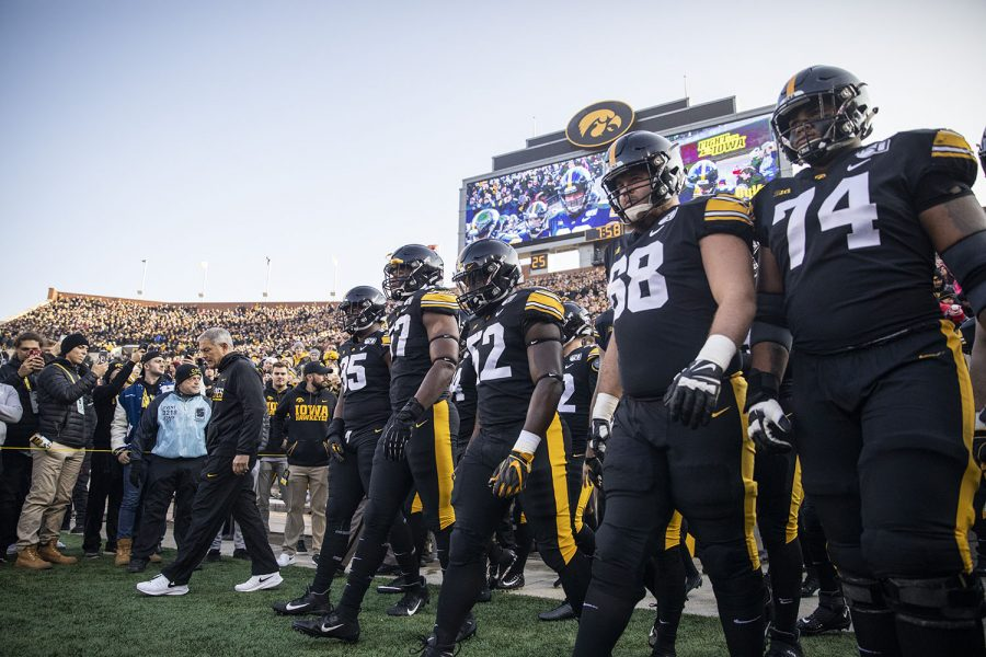 Iowa+head+coach+Kirk+Ferenzt+and+members+of+the+Iowa+football+team+walk+onto+the+field+before+a+football+game+between+Iowa+and+Minnesota+at+Kinnick+Stadium+on+Saturday%2C+November+16%2C+2019.+The+Hawkeyes+defeated+the+Gophers%2C+23-19.+