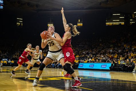 Iowa forward Monika Czinano looks to shoot during a women