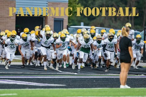 West players run onto the field during a football game between Iowa City West and Liberty High School in North Liberty on Friday, Aug. 28, 2020. The Trojans defeated the Lightning, 27-0.