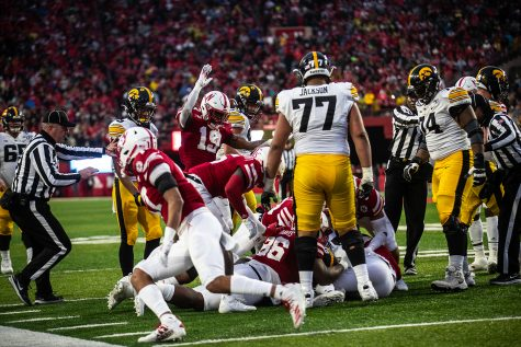 The Nebraska defense jumps on a loose ball during the game against Nebraska on Friday, November 29, 2019. The Hawkeyes defeated the Corn Huskers 27-24.