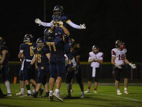 Regina Running Back Theo Kolie celebrates with Offensive Tackle Josh Gaffey after a touchdown during Regina Catholic Education vs. Lisbon High School at Regina on Friday, Sept. 25, 2020. The Royals defeated the Lions 56-26. (Katie Goodale/The Daily Iowan)