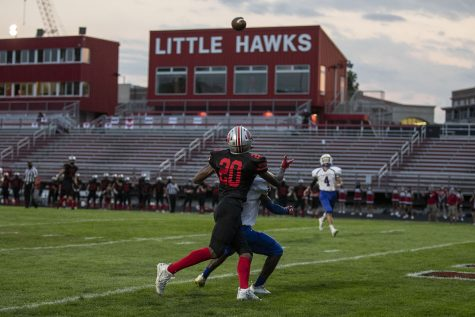 Iowa City High Wide Receiver Jovan Harris looks back to catch a pass during the Iowa City High vs. Davenport Central football game at Iowa City High on Friday, Aug. 28, 2020. The Little Hawks defeated the Blue Devils 35-14. Due to COVID-19, Iowa City High players were asked to wear masks and fans weren't allowed in the stands. Davenport Central's players were not required to wear masks. Davenport Central saw some fans turn out to their section of the stadium and City High fans gathered outside of school property along the fence.