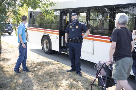 Officer A. Farrell ICPD pratices safety by maintaining 6 feet distance, wearing a mask and gloves, while talking to bus passengers at  Walmart 919 Hwy. 1, W. . seen on Saturday, Sep.5,2020.