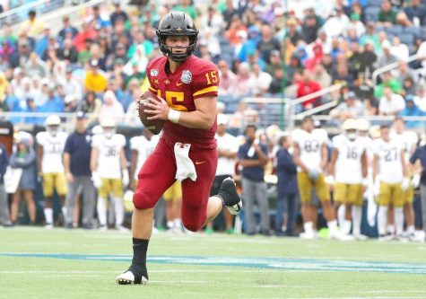 Iowa State Cyclones quarterback Brock Purdy (15) runs out of the pocket against the Notre Dame Fighting Irish during the first half at Camping World Stadium.