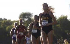 The University of Iowa's Jessica McKee leads a pack of runners during the Hawkeye Invitational on Friday, Sept. 6, 2019 at the Ashton Cross Country Course. The Hawkeyes prevailed over six other teams to win first place overall in the men's and women's races. McKee finished in 20th place with a time of 14:53.