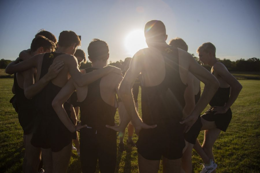 The Iowa men's team huddle up before starting the 6k during the Hawkeye Invitational at Ashton Cross Country Course on Friday, September 6, 2019. The Hawkeyes defeated six other teams to finish first overall for both men's and women's races.
