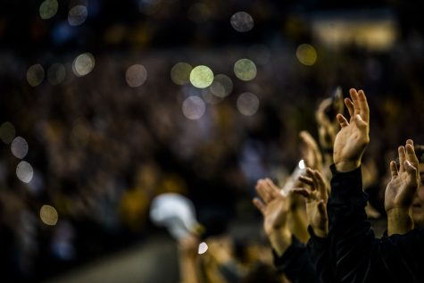 Fans wave after the first quarter during the Iowa football game against Miami (Ohio) at Kinnick Stadium on Saturday, August 31, 2019. The Hawkeyes defeated the Redhawks 38-14.