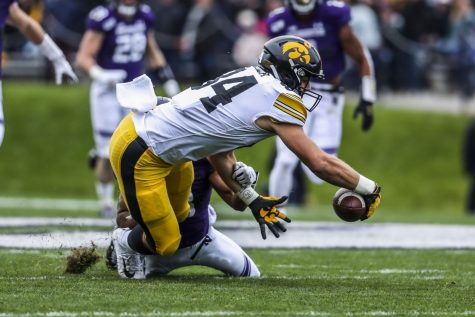 Iowa tight end Sam LaPorta dives after losing his grip on the ball during the Iowa vs. Northwestern football game at Ryan Field on Saturday, October 26, 2019. The Hawkeyes defeated the Wildcats 20-0. The pass was later ruled incomplete.