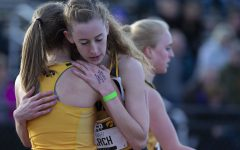 Iowa runner Mary Arch hugs her teammate after the 3000m run at the Musco Twilight Invitational at the Cretzmeyer Track on Saturday, April 13, 2019. Arch finished fourth with a time of 10:23:58. The Hawkeyes won 10 events during the meet. The Iowa women ranked first with 183 points, and the men ranked fifth 76 points.