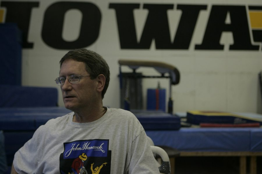 Then-head coach of Iowa Men's Gymnastics, Tom Dunn, watches his gymnasts on Thursday, Dec. 14, 2006 in the Iowa Gymnastics practice room.