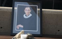 A memorial for Ruth Bader Ginsburg is seen outside the University of Iowa's College of Law building on Monday, Sept. 21, 2020. Ginsburg passed away Friday, Sept. 18, 2020.