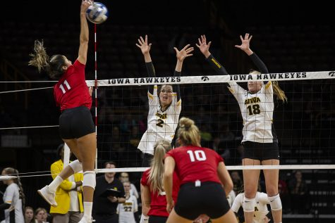 Courtney Buzzerio and Hannah Clayton try to stop the Huskers from scoring during the Iowa and Nebraska volleyball game. The Huskers defeated the Hawkeyes in three sets on November 9, 2019, at Carver-Hawkeye Arena.