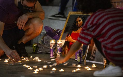 Participants light candles during a memorial service held for Makeda Scott on the University of Iowa Pentacrest on Friday, September 25, 2020. According to the Johnson County Sherriff, Scott had drowned at Lake MacBride on June 7th of this year. Scott was 21 at the time, having recently graduated from Iowa with a degree in gender, women's, and sexuality studies.