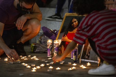 Participants light candles during a memorial service held for Makeda Scott on the University of Iowa Pentacrest on Friday, September 25, 2020. According to the Johnson County Sherriff, Scott had drowned at Lake MacBride on June 7th of this year. Scott was 21 at the time, having recently graduated from Iowa with a degree in gender, women