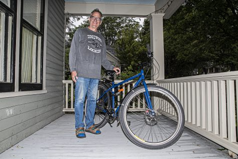 "City council member, John Thomas poses for a portrait in from of his home in Iowa City on Tuesday, September 8th, 2020. John along with several other city council members and citizens are in the process of creating a bike advocacy committee to help Iowa City reach ""gold"" tier in bike friendly cities."