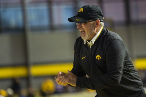 Iowa associate head coach Randy Hasenbank cheers on 3000m runners during the Hawkeye Invitational at the University of Iowa Recreation Building on Saturday, Jan 11, 2020.
