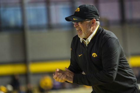 Iowa associate head coach Randy Hasenbank cheers on 3000m runners during the Hawkeye Invitational at the University of Iowa Recreation Building on Saturday, Jan 11, 2020.