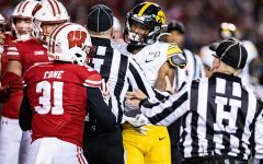 Officials seperate Iowa's Ihmir Smith-Marsette and Wisconsin's Madison Cone during a football game between Iowa and Wisconsin at Camp Randall Stadium in Madison on Saturday, November 9, 2019. The Badgers defeated the Hawkeyes, 24-22.