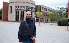 Chris Patton, the man behind the ICPD police log, standing in front of the Alder Journalism Building.
