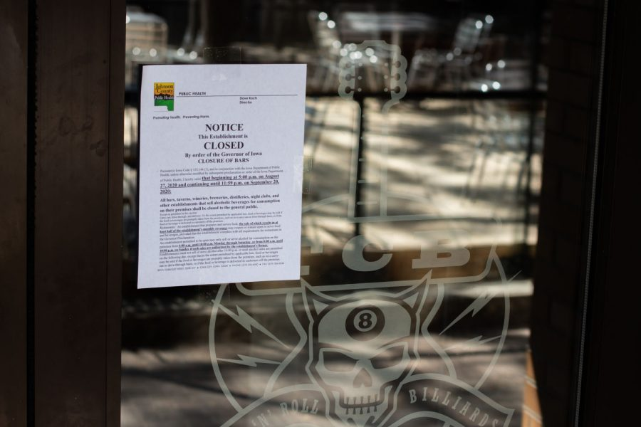 The JHC posts signs announcing bar closure in Iowa City on Thursday, August 27th, 2020. Governor Kim Reynolds announced that bars must close at 5p.m. to help with COVID.