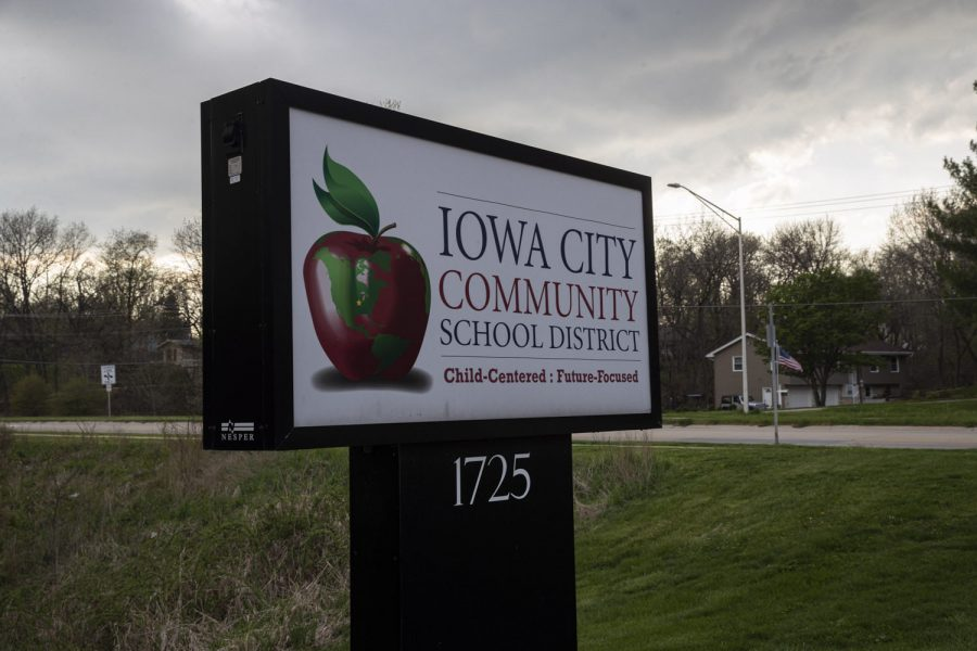 A sign for the Iowa City Community School District is seen outside the districts administration building on Tuesday, April 28.