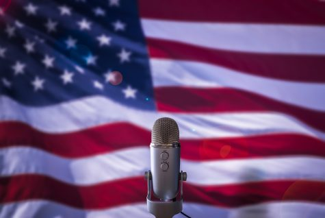 A Microphone In Front Of A USA Flag Ready For A Public Address From The President Or Other Government Figure.
