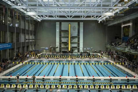 Swimmers compete in the 200 backstoke during a swim meet at the CRWC on January 11, 2020 between Iowa, Illinois, and Notre Dame. The Hawkeye men's team defeated the fighting Irish 159.50 to 140.50 while the Hawkeye women's team defeated the fighting Illini 223 to 86 and lost to the fighting Irish 99.50 to 209.50.